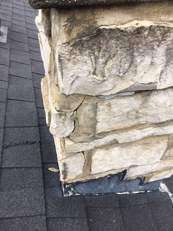 Stone chimney is deteriorating leaving the potential for water penetration.